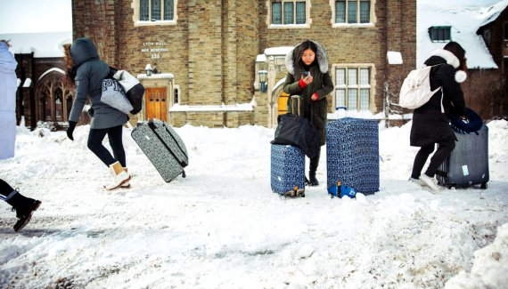 Cornell students at winter break with suitcases