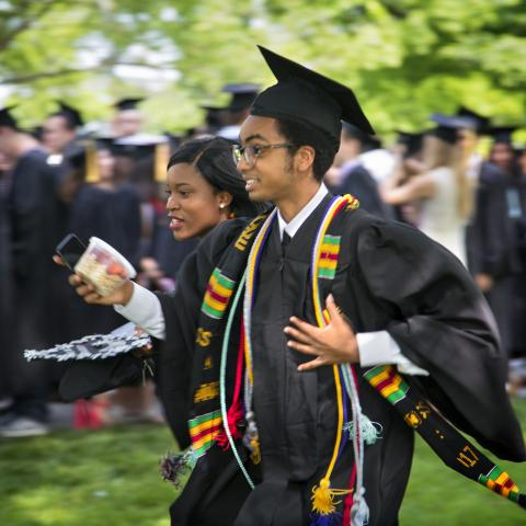 international students running at commencement